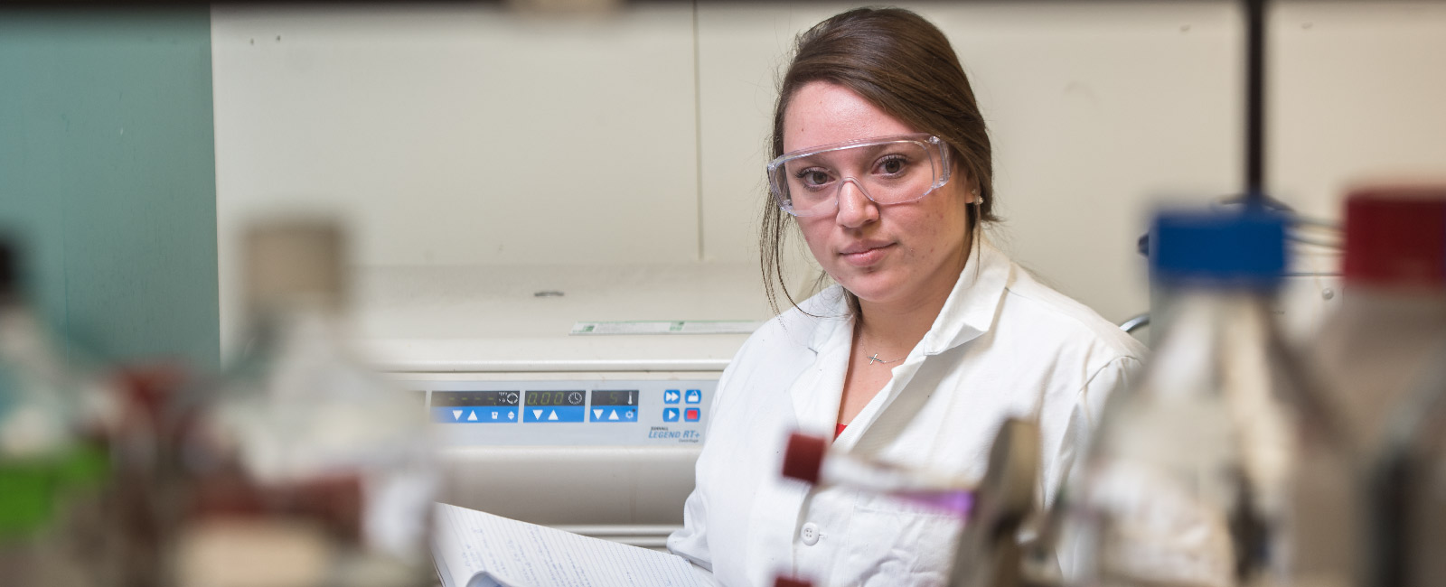 Graduate student working in a research laboratory